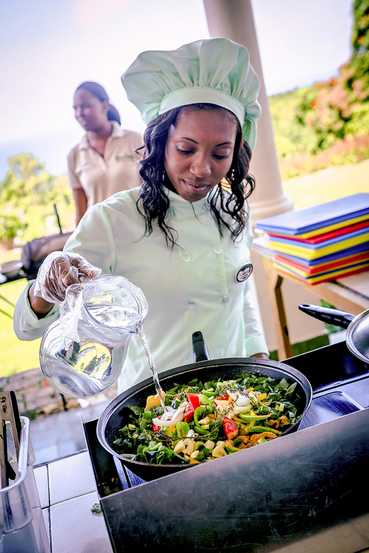 Jamaican chef preparing food