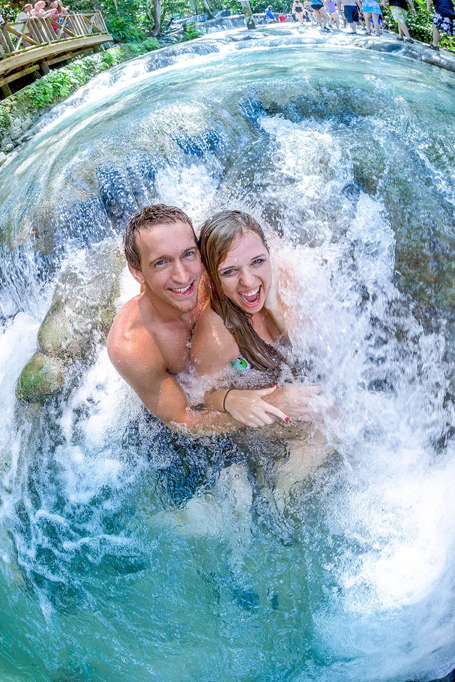 Couple posing under the Dunn's River Falls