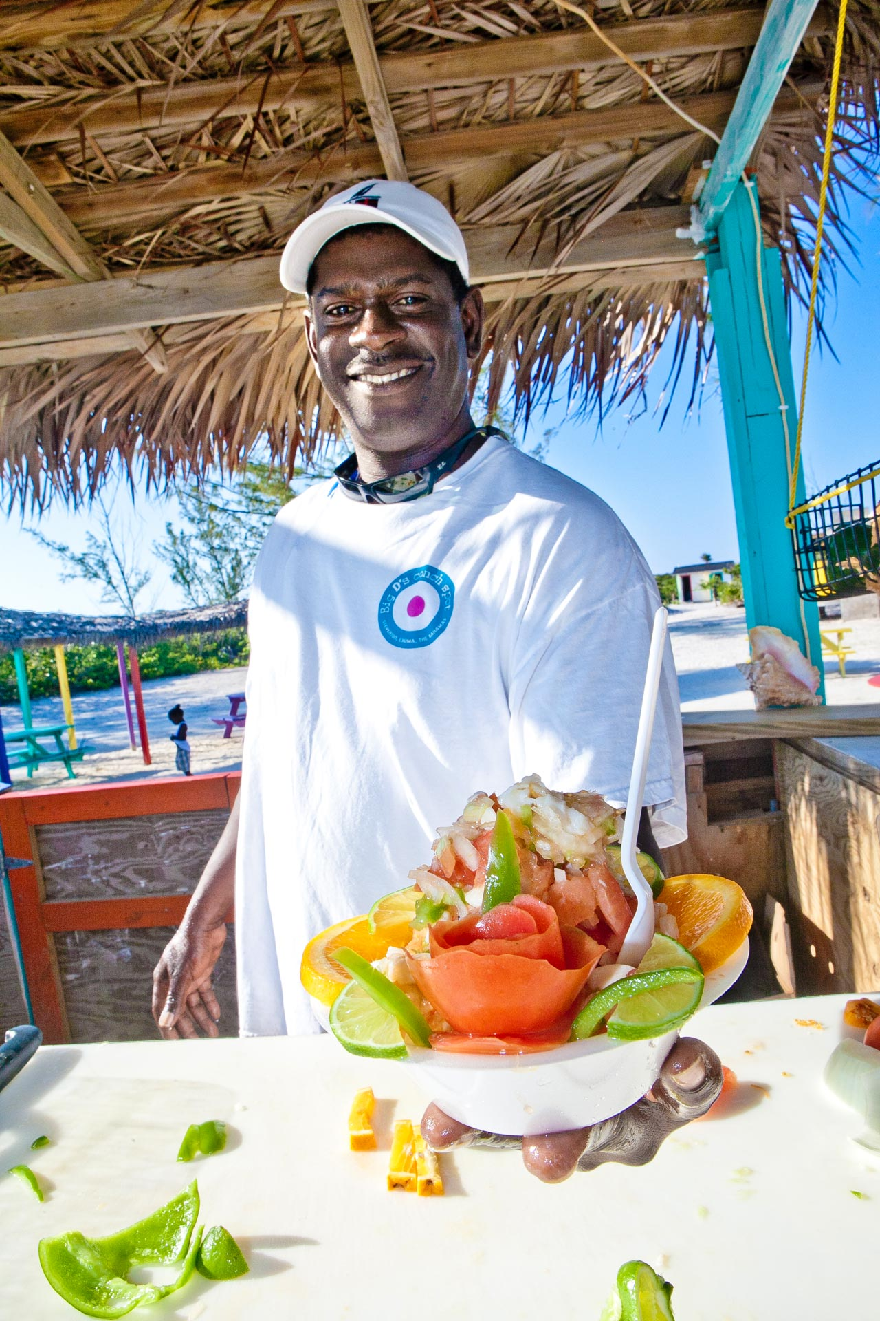 A Bahamian holding a bowl of Conch Salad