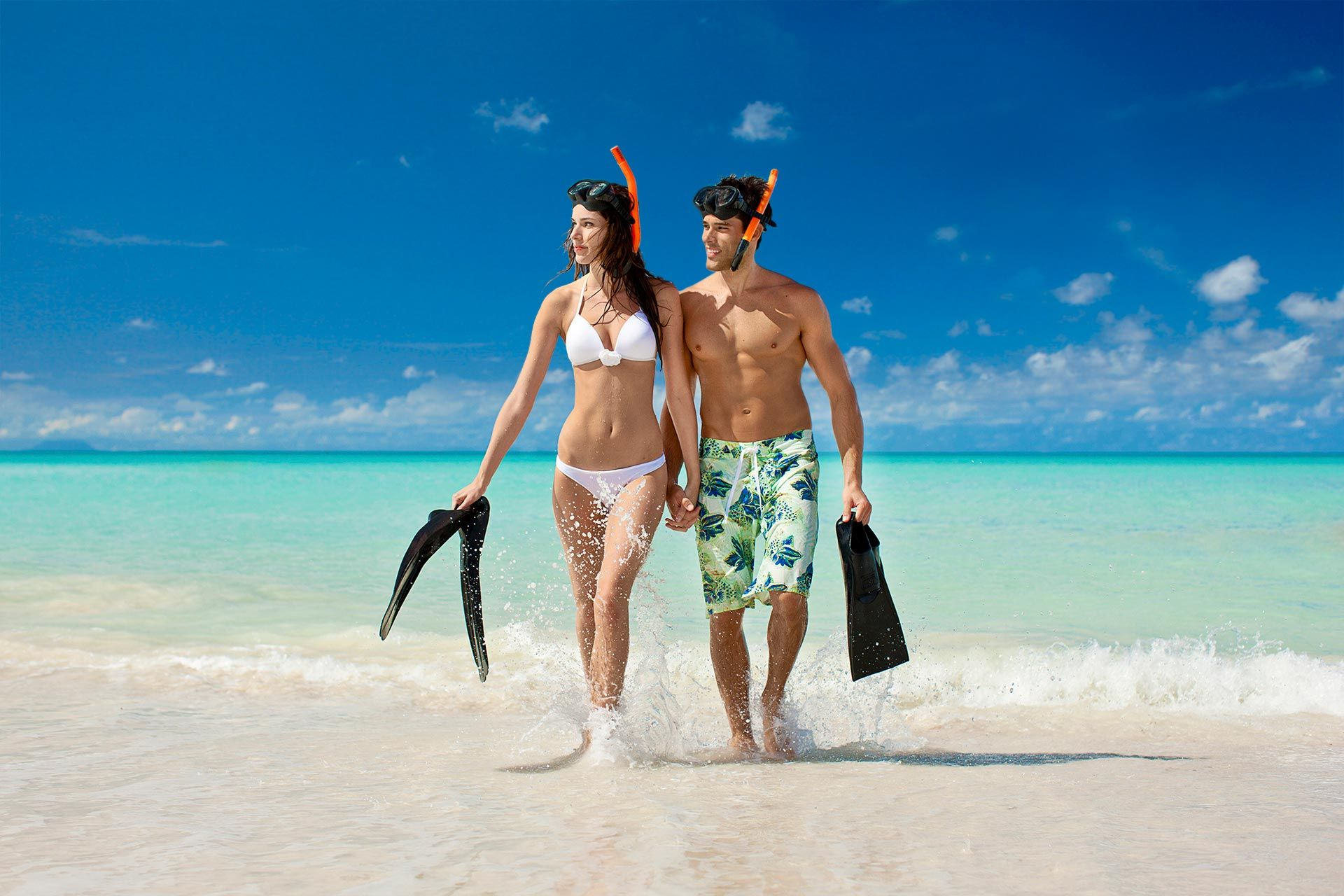 Couple on the beach with snorkeling gear
