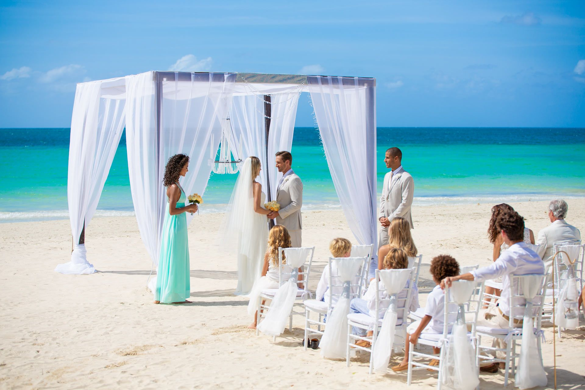 wedding on beach with guests
