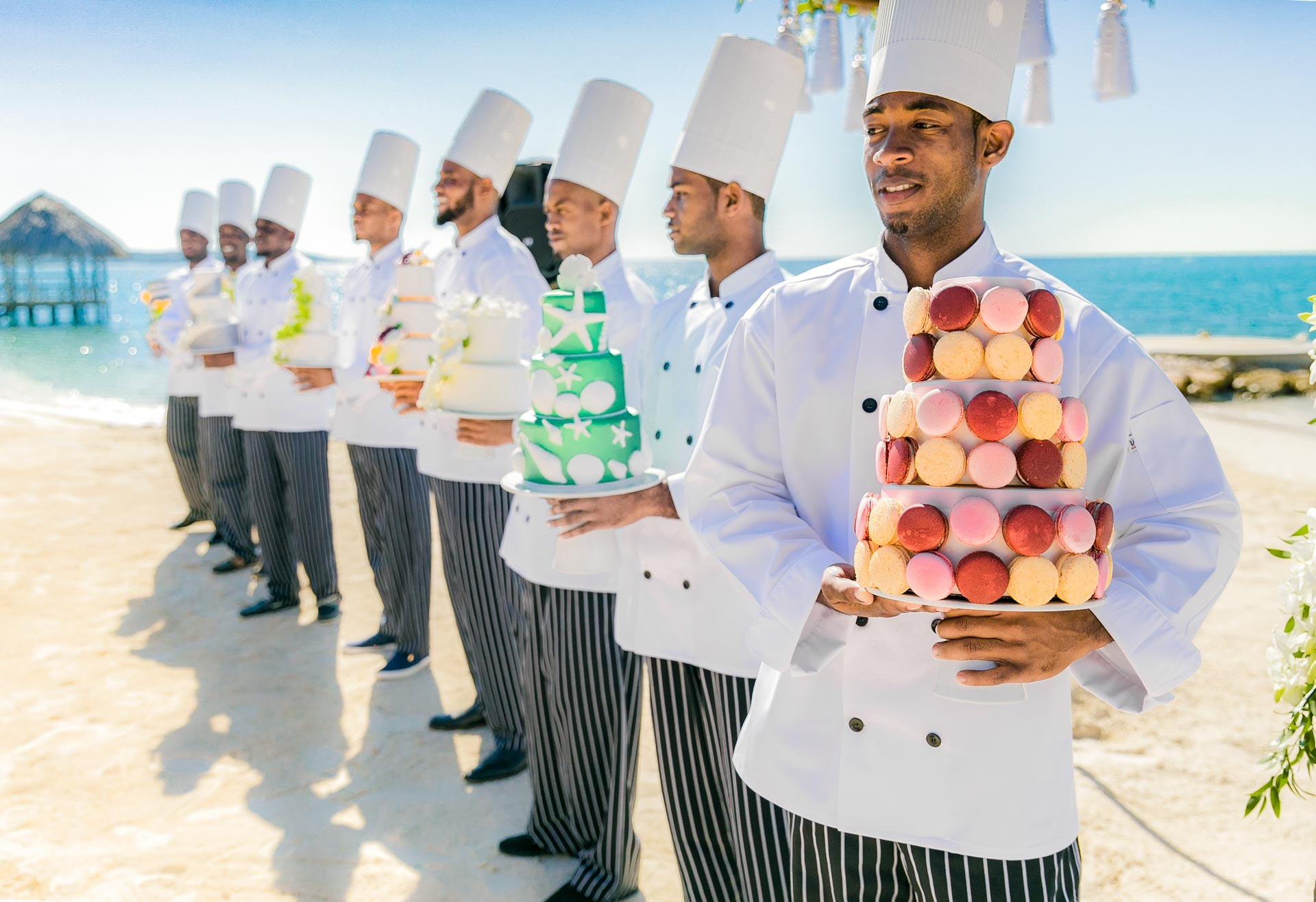 Row of chefs with cakes