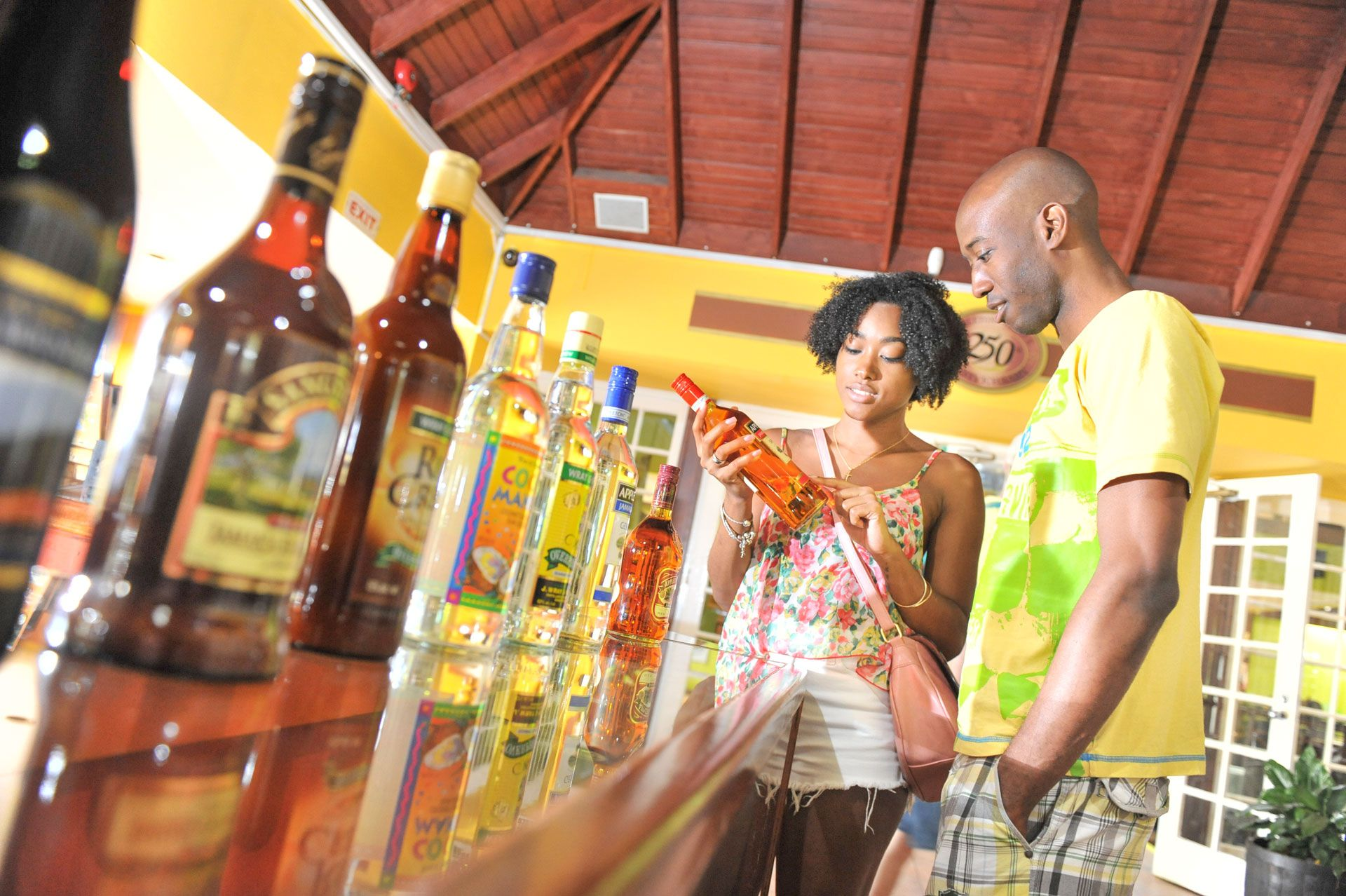 Couple looking at Rum in Jamaica