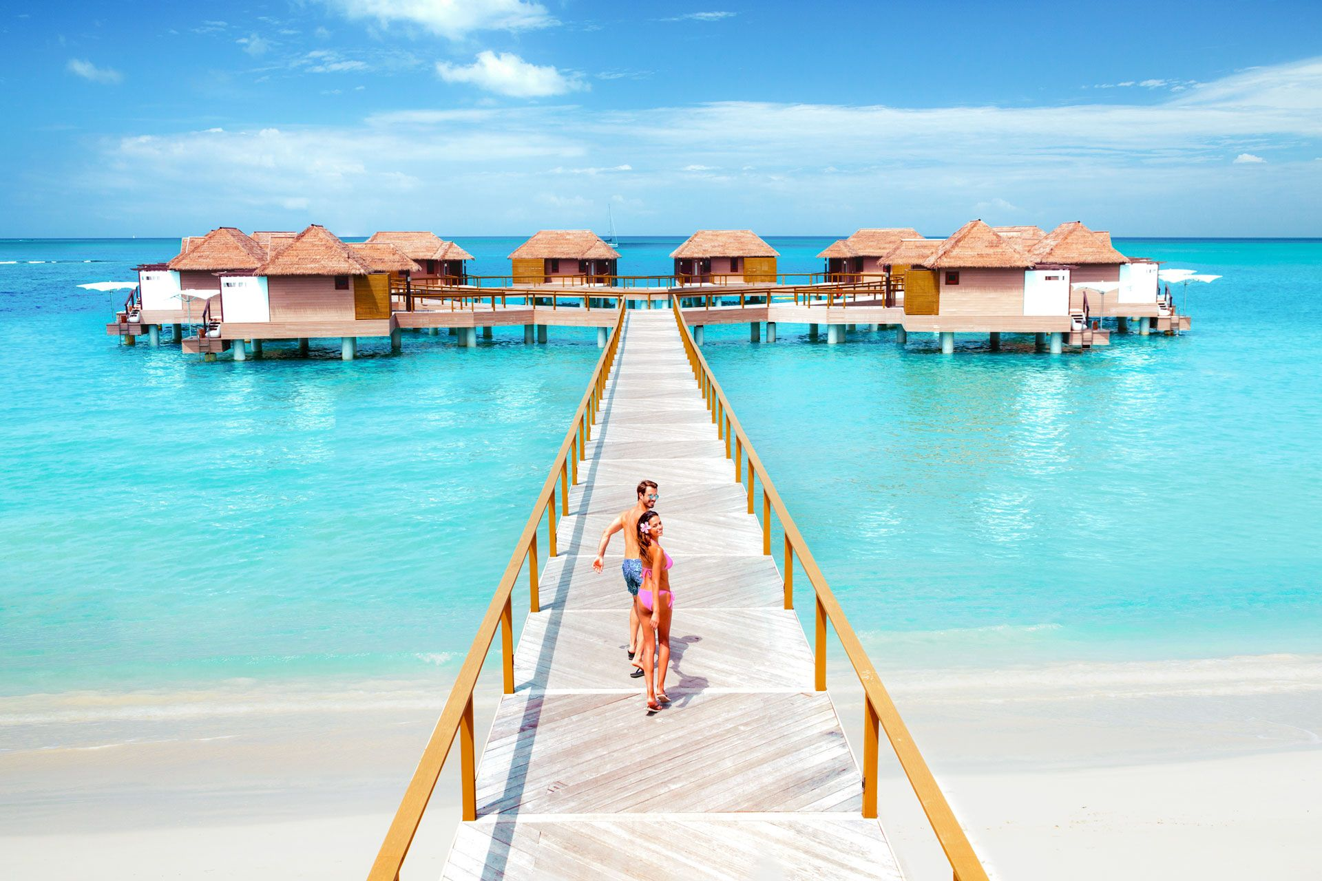 Couple at Sandals overwater bungalows