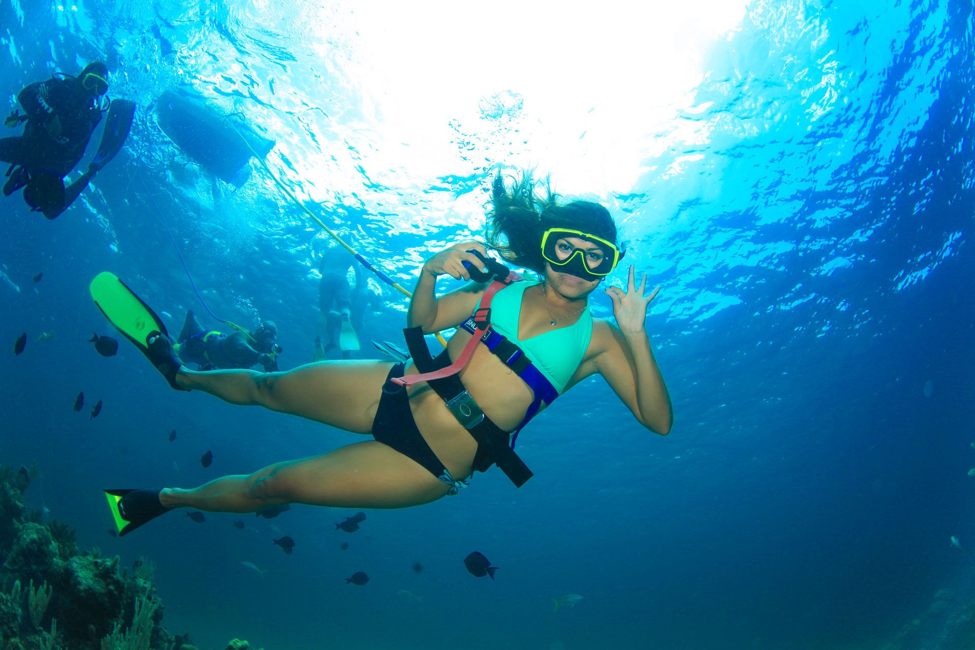 Female diver giving OK signal