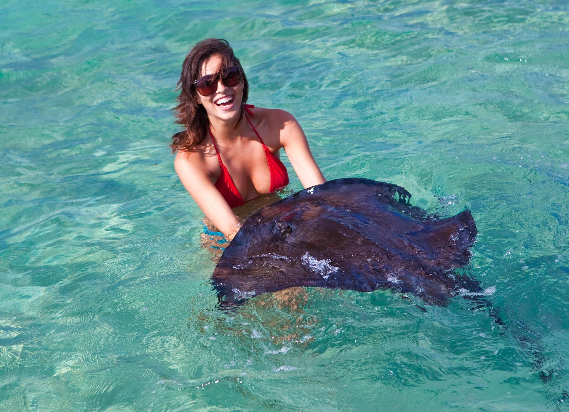 woman holding a stingray