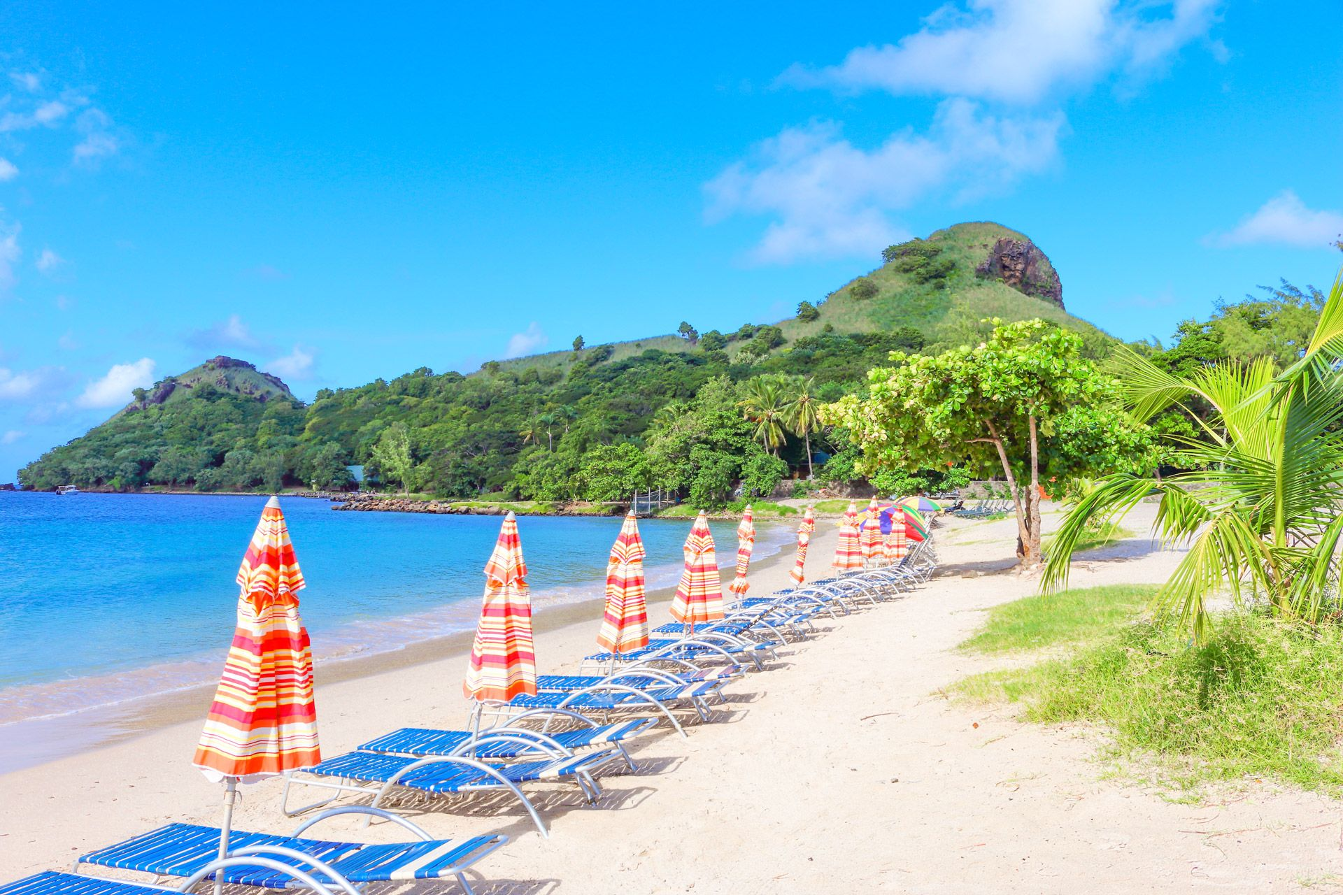 Pigeon-island-beach-with-umbrellas