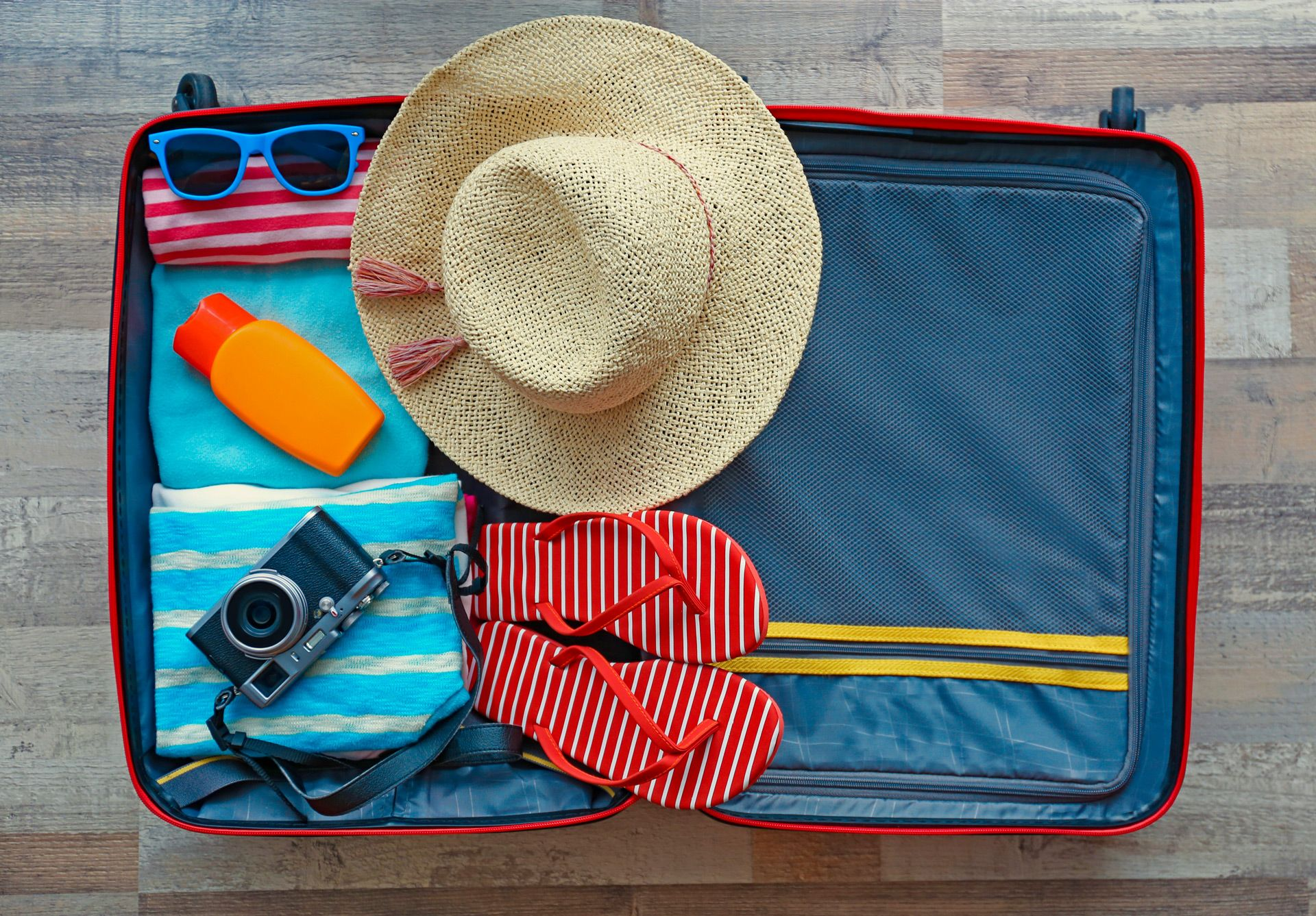 a caribbean traveler's packed suitcase essentials