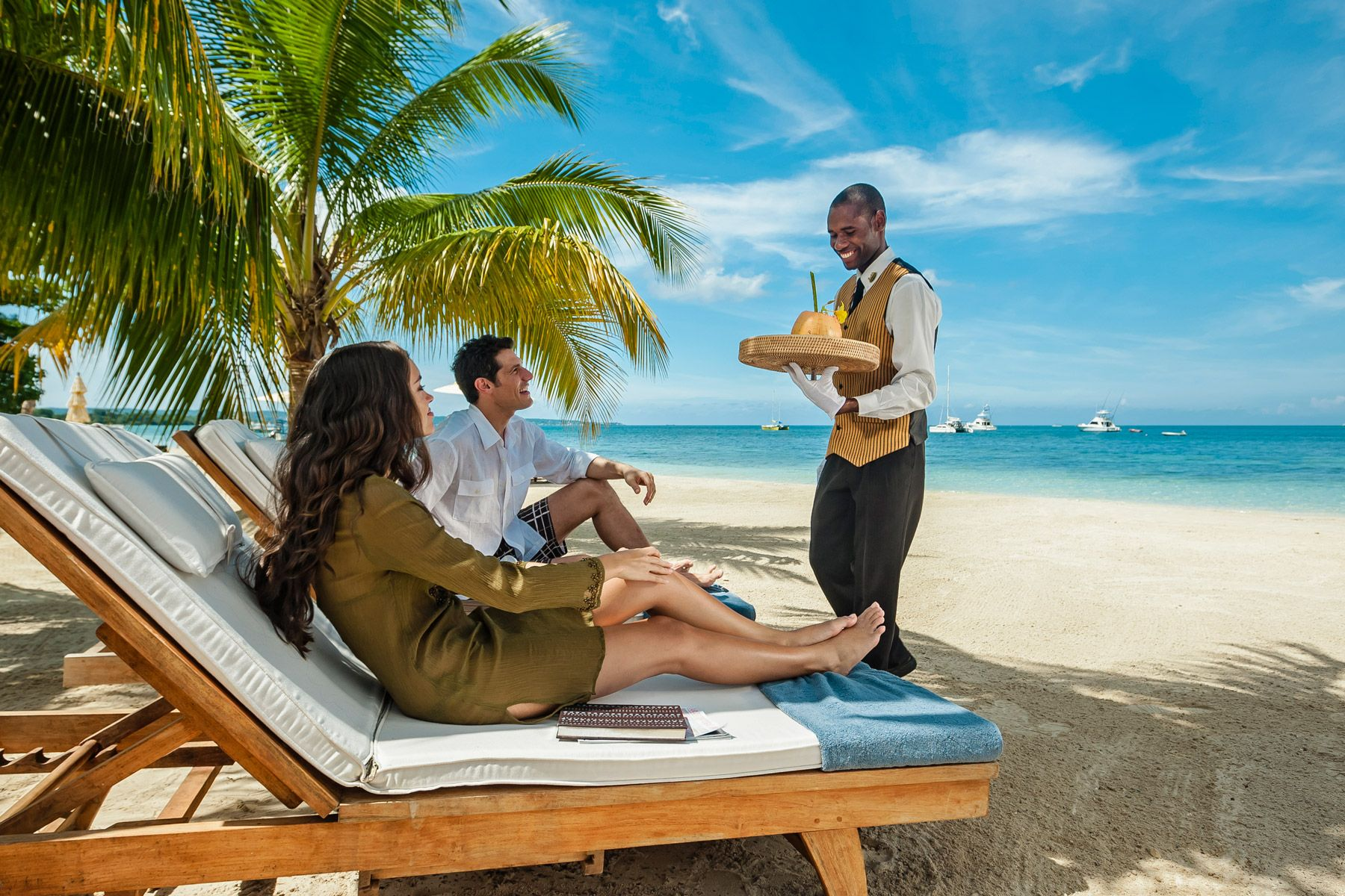 couple enjoying butler service at sandals negril beach