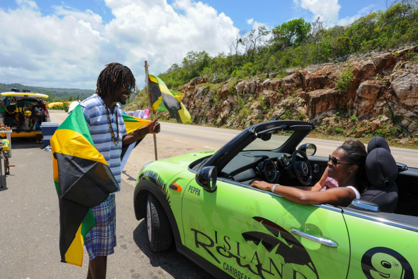 guests interacting with local while on mini cooper ocho rios tour