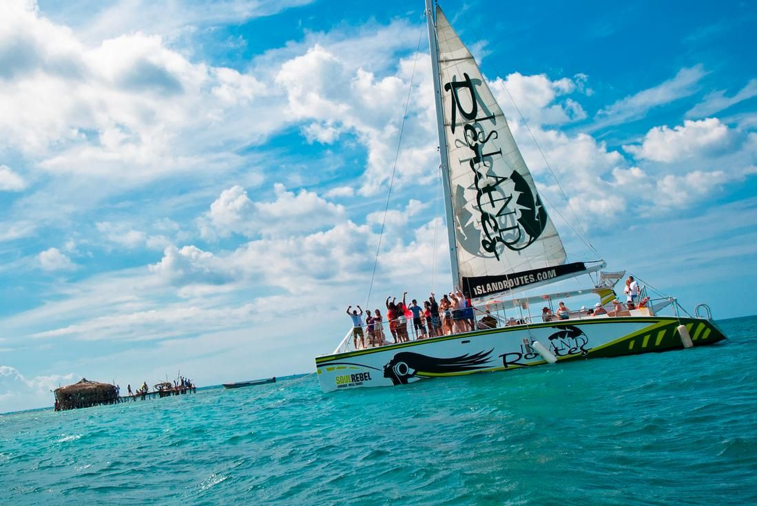 island routes catamaran cruise with guests at floyd's pelican bar