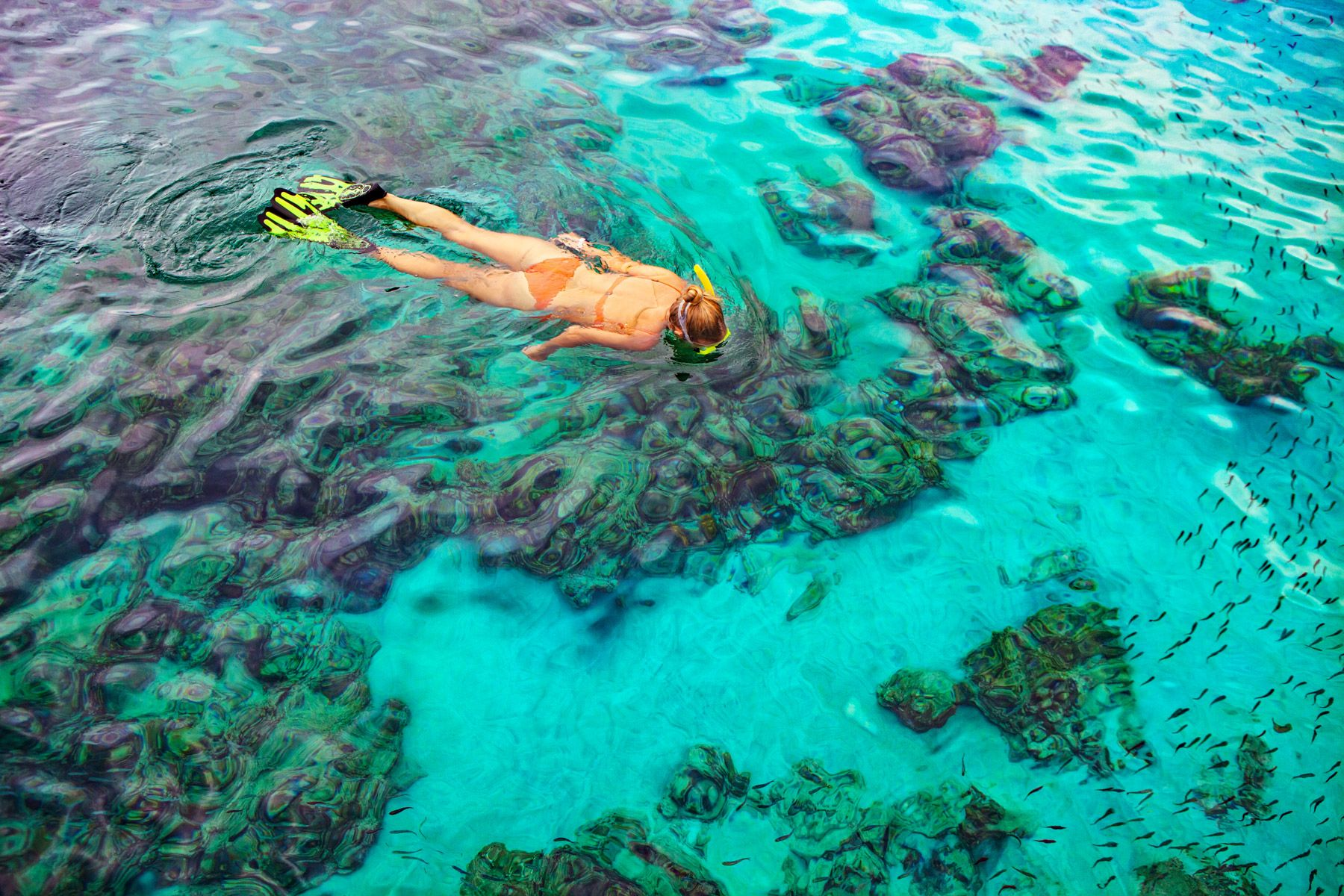 young girl snorkel crystal water