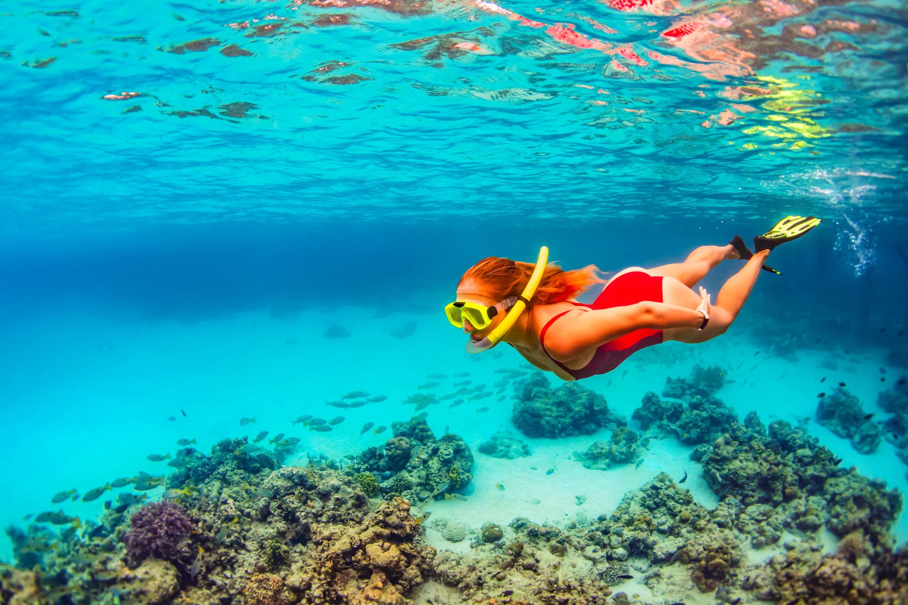 young girl underwater snorkel
