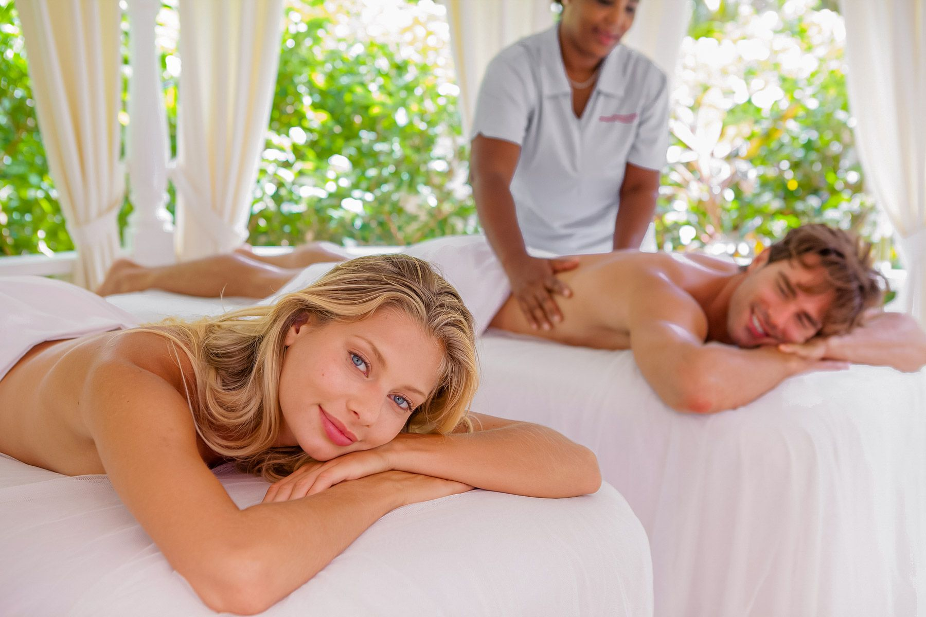 couple enjoying a relaxing massage at the red lane spa in sandals grande saint lucian