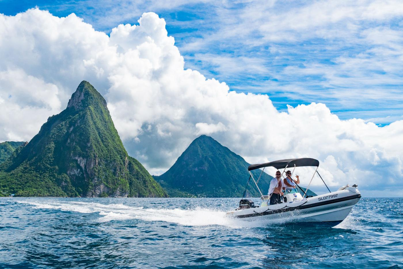 guests ridin speed boat alond st. lucia's coast