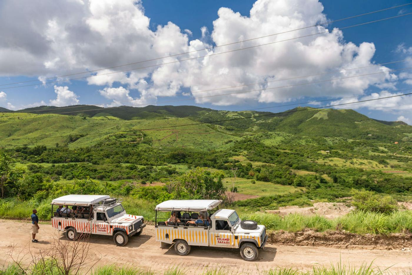 safari land rovers making their ways through the island sites