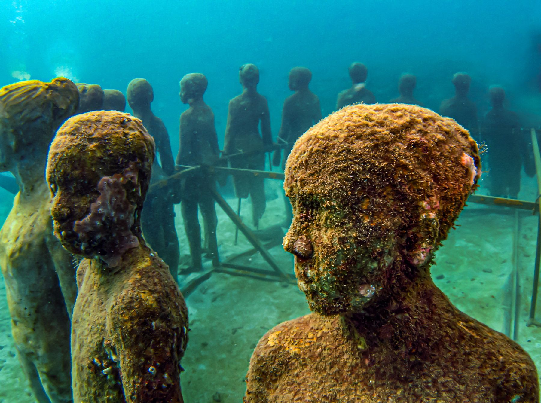 Grenada Underwater Sculpture Park children face close up