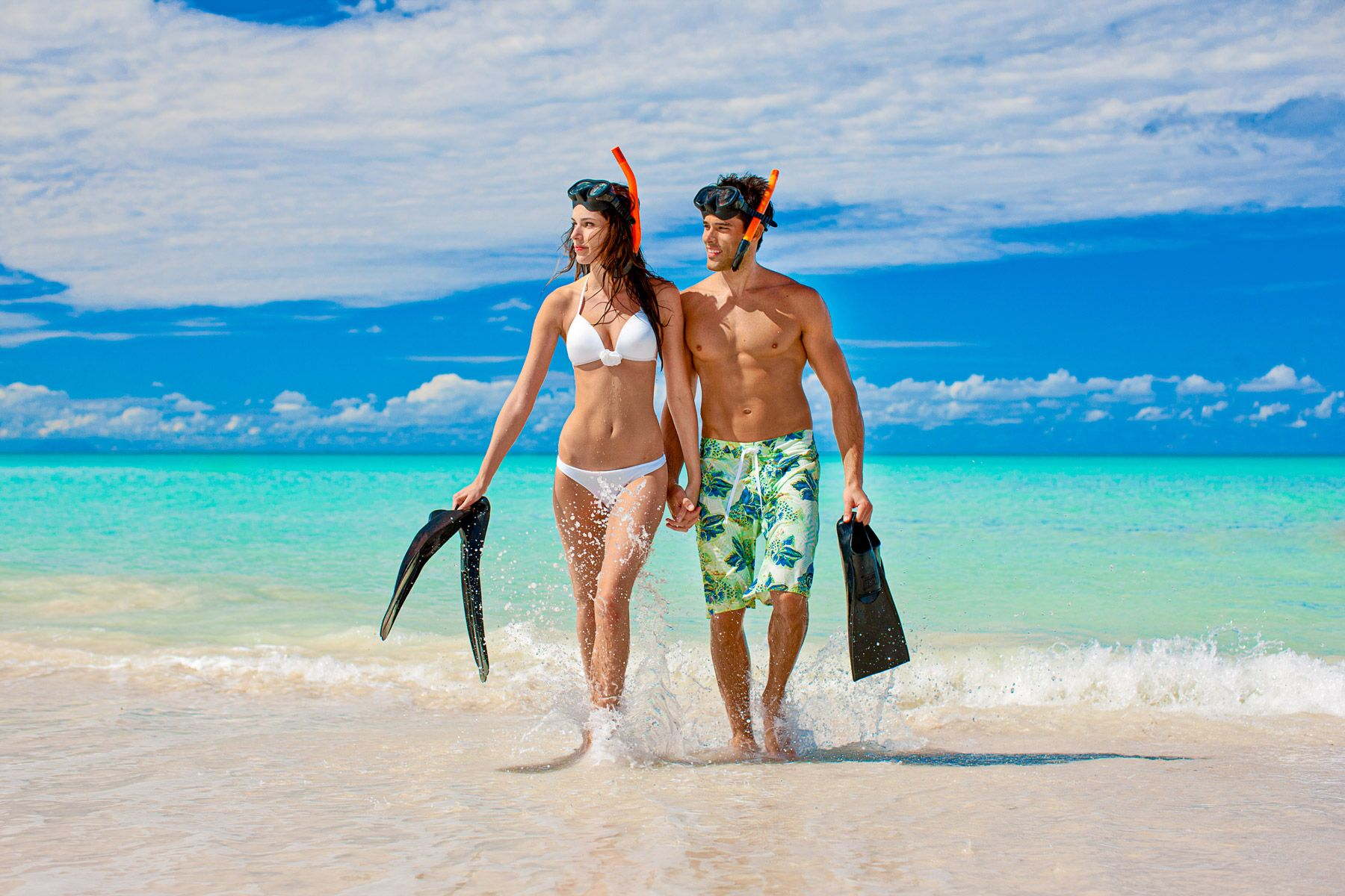 Couple snorkeling gear sandals grande antigua