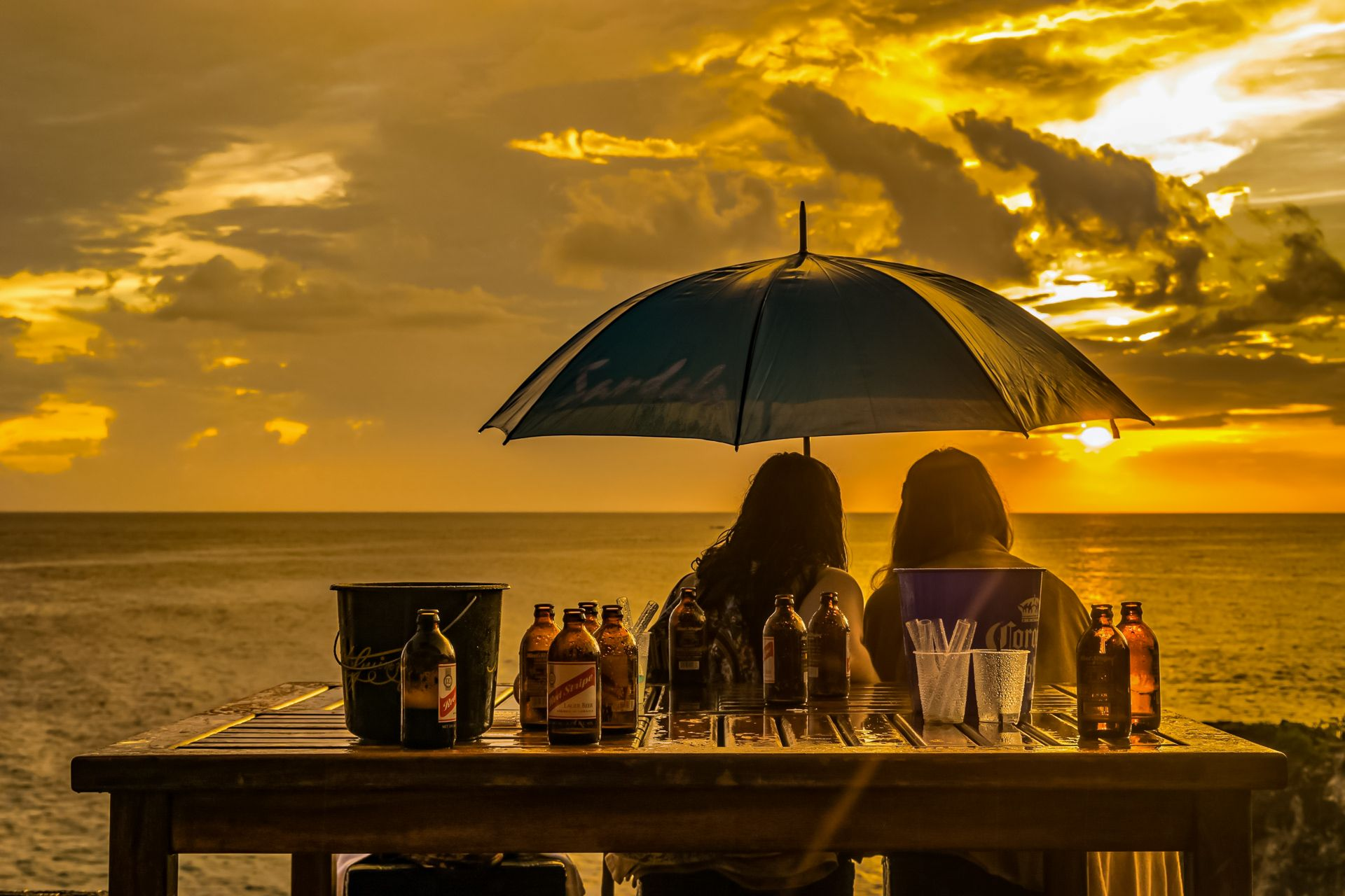 Couple watching sunset Ricks Cafe Negril