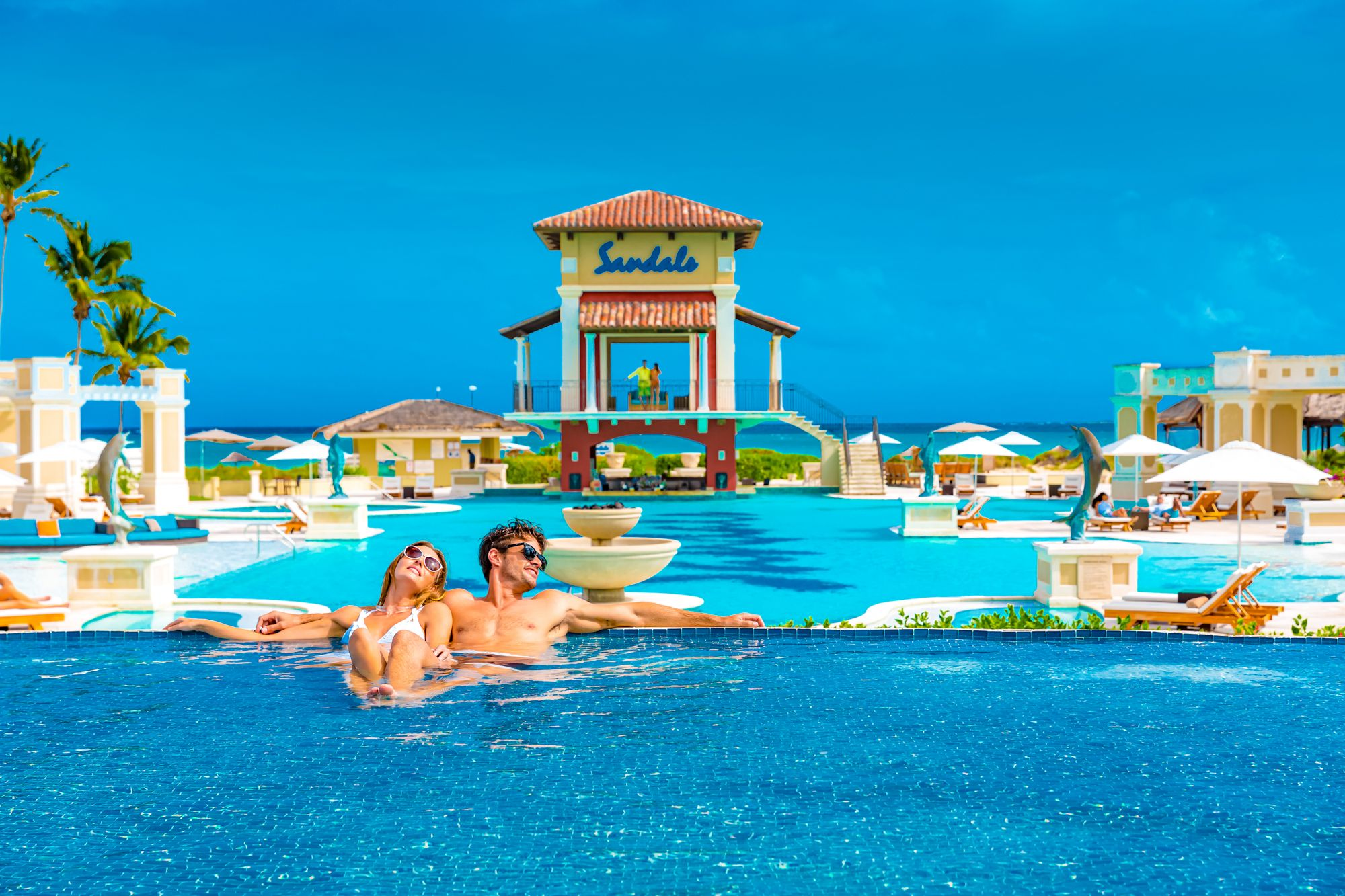 Sandals Emerald Bay Main Pool Couple