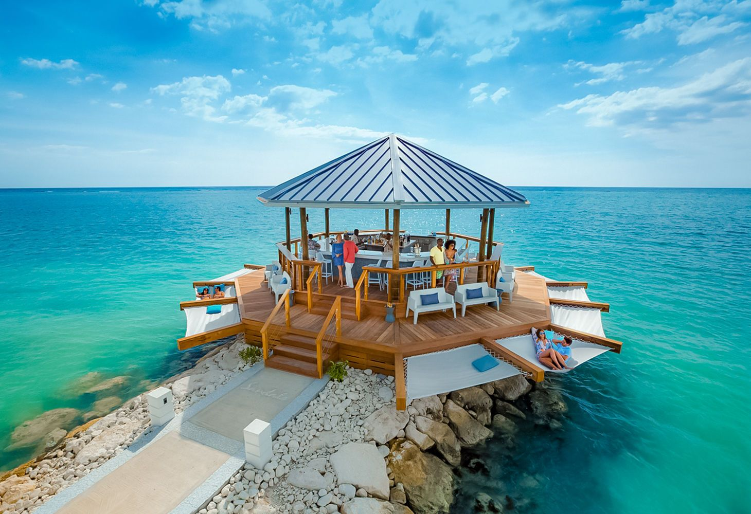 over-the-water bar at Sandals South Coast